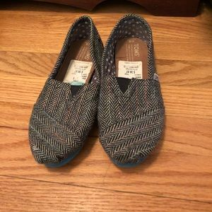 Toms.  Size 6